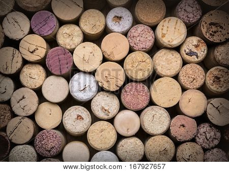 wine corks on wooden table bakground textute