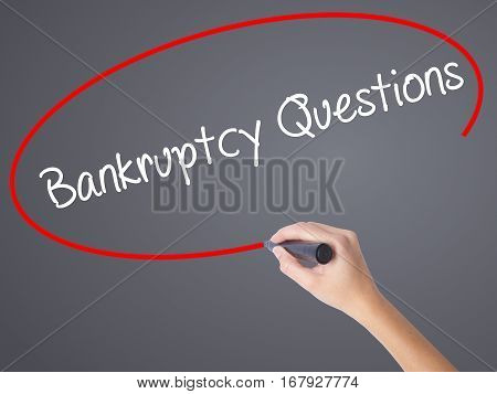 Woman Hand Writing Bankruptcy Questions With Black Marker On Visual Screen