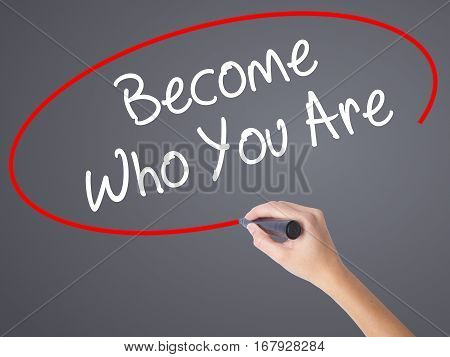 Woman Hand Writing Become Who You Are With Black Marker On Visual Screen