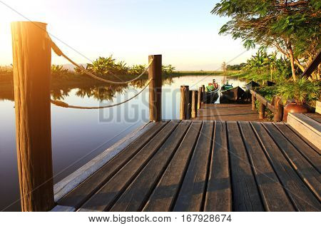 View with a wooden jetty, bamboo boats in sunset light, Inle Lake (Inle Sap), Taunggyi District, Shan State, Myanmar (Burma)