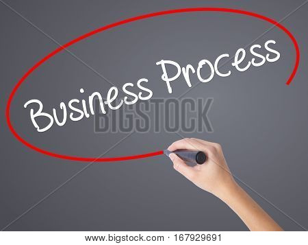 Woman Hand Writing Business Process  With Black Marker On Visual Screen.