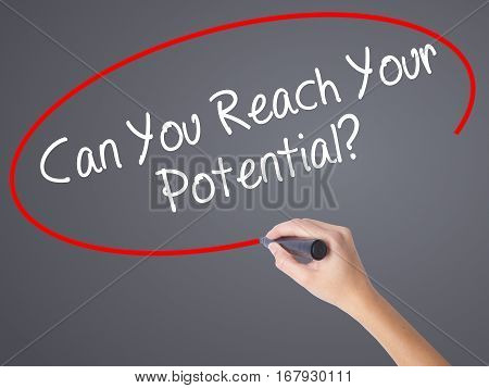 Woman Hand Writing Can You Reach Your Potential? With Black Marker On Visual Screen