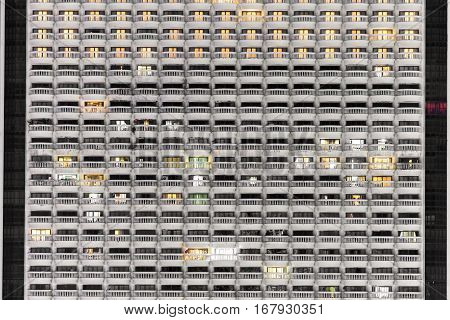 New block of modern apartments or condominium with balconies in night