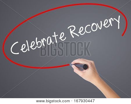 Woman Hand Writing Celebrate Recovery With Black Marker On Visual Screen