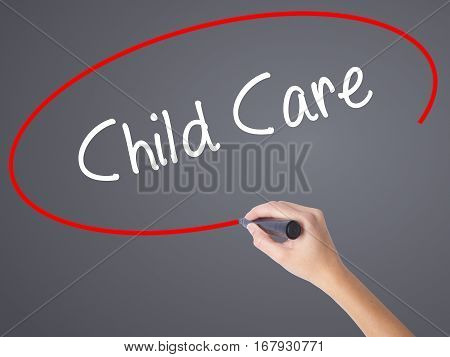 Woman Hand Writing Child Care With Black Marker On Visual Screen