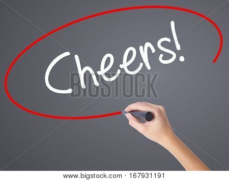 Woman Hand Writing Cheers! With Black Marker On Visual Screen