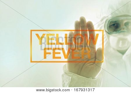Yellow fever quarantine concept with medical scientist in protective clothing gesturing stop sign