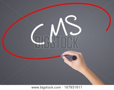Woman Hand Writing Cms (custom Management System) With Black Marker On Visual Screen