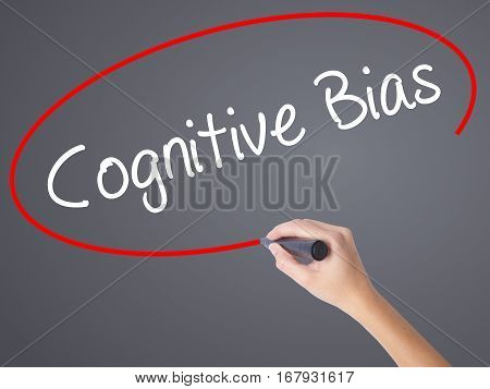 Woman Hand Writing Cognitive Bias With Black Marker On Visual Screen