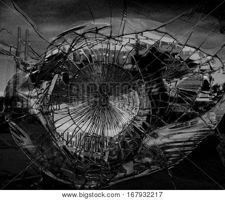 Broken mirror glass in which is reflected the city. Monochrome variant. Dark colors give a gloomy, mournful mood and mystery. Suitable for the illustration of the Apocalypse, destruction. Horizontal.