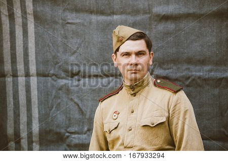 Gomel, Belarus - May 9, 2015: Close up portrait of unidentified re-enactor dressed as Russian Soviet Infantry Soldier Of World War II