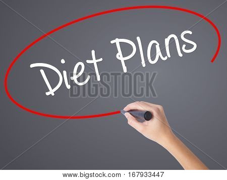 Woman Hand Writing  Diet Plans  With Black Marker On Visual Screen