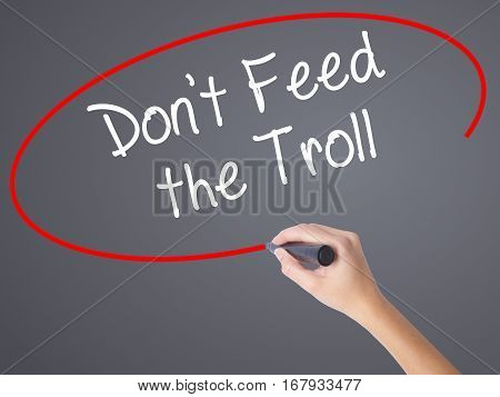 Woman Hand Writing Don't Feed The Troll With Black Marker On Visual Screen.