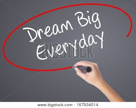 Woman Hand Writing Dream Big Everyday With Black Marker On Visual Screen