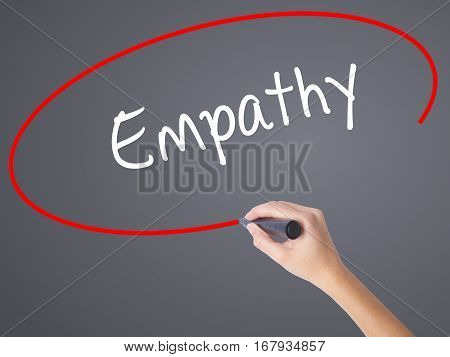 Woman Hand Writing Empathy With Black Marker On Visual Screen