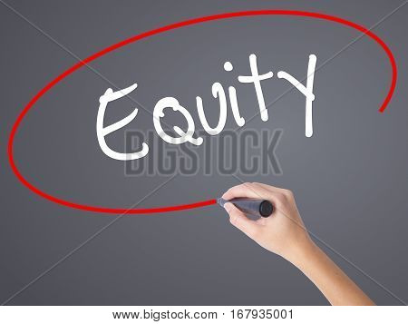 Woman Hand Writing Equity With Black Marker On Visual Screen