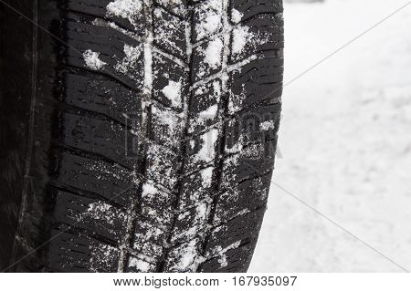 Winter Tire On A Snowy Road. Detailed View Of A Sample Of Winter Tires.