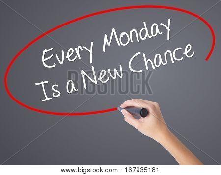 Woman Hand Writing Every Monday Is A New Chance With Black Marker On Visual Screen