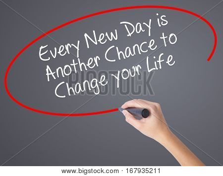 Woman Hand Writing Every New Day Is Another Chance To Change Your Life With Black Marker On Visual S