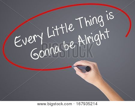 Woman Hand Writing Every Little Thing Is Gonna Be Alright With Black Marker On Visual Screen