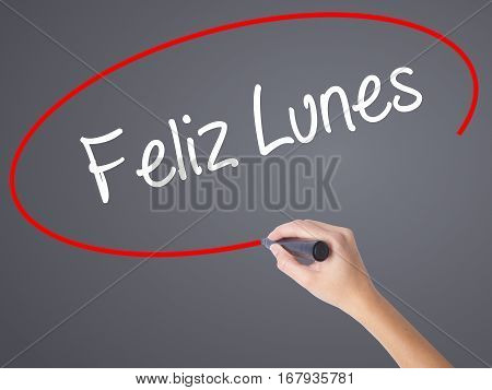 Woman Hand Writing Feliz Lunes (happy Monday In Spanish) With Black Marker On Visual Screen