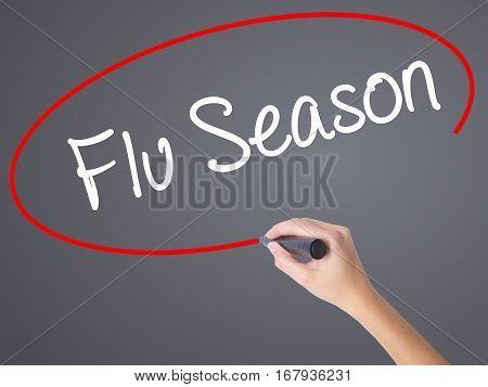 Woman Hand Writing  Flu Season With Black Marker On Visual Screen