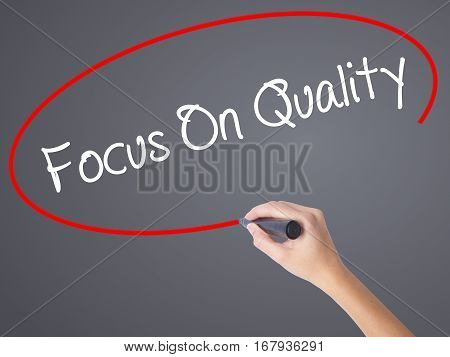 Woman Hand Writing Focus On Quality With Black Marker On Visual Screen