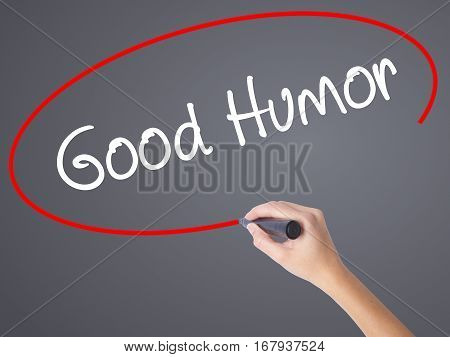 Woman Hand Writing Good Humor With Black Marker On Visual Screen.