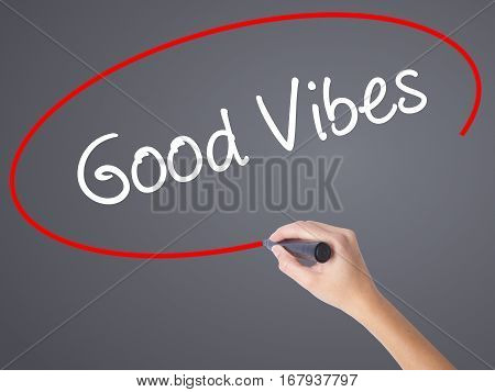 Woman Hand Writing Good Vibes With Black Marker On Visual Screen