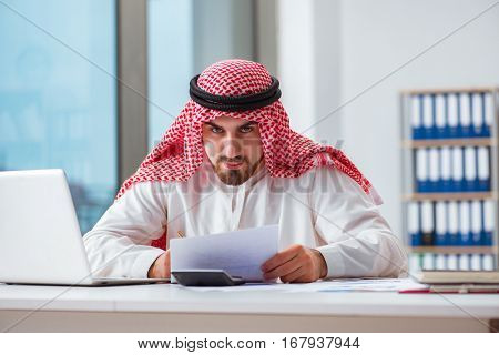 Arab businessman working on laptop computer