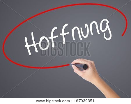 Woman Hand Writing Hoffnung (hope In German)   With Black Marker On Visual Screen