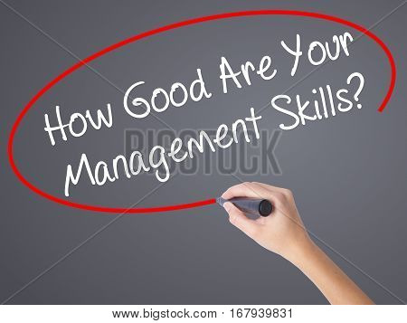 Woman Hand Writing How Good Are Your Management Skills? With Black Marker On Visual Screen