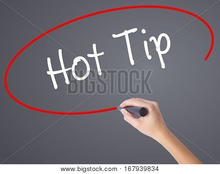 Woman Hand Writing Hot Tip With Black Marker On Visual Screen.