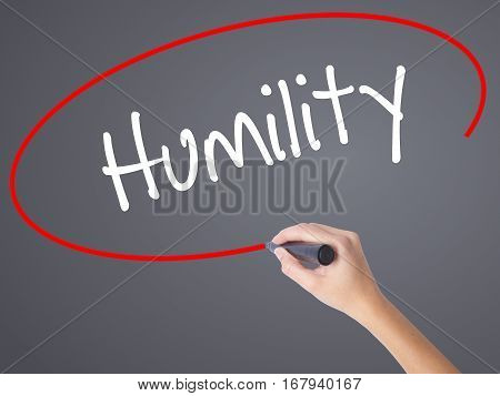 Woman Hand Writing Humility  With Black Marker On Visual Screen.