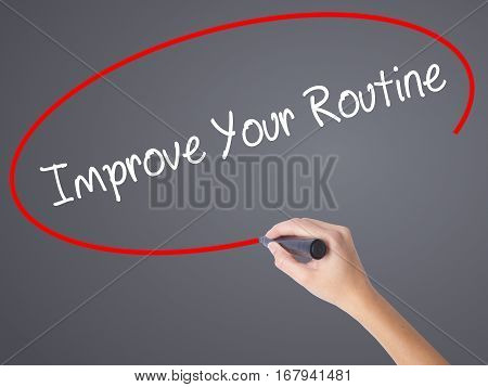 Woman Hand Writing Improve Your Routine With Black Marker On Visual Screen