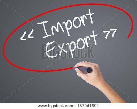 Woman Hand Writing Import - Export With Black Marker On Visual Screen.