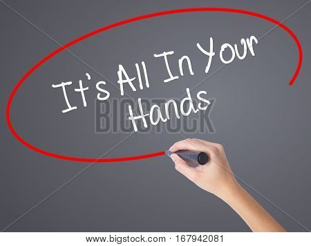 Woman Hand Writing It's All In Your Hands  With Black Marker On Visual Screen.