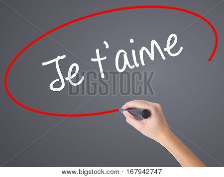 Woman Hand Writing Je T'aime ( I Love You In French)  With Black Marker On Visual Screen