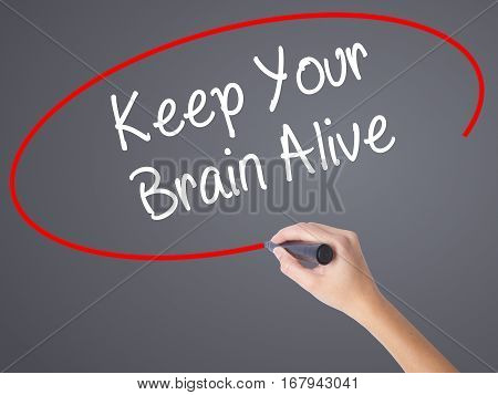 Woman Hand Writing Keep Your Brain Alive With Black Marker On Visual Screen