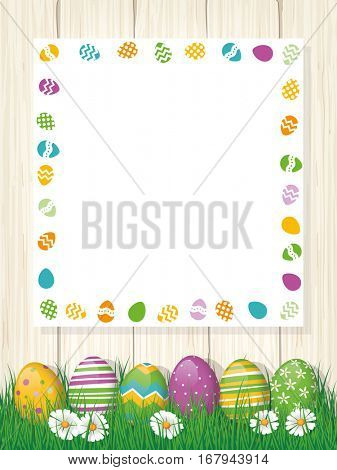 Happy Easter greeting Card, painted eggs in grass, white board with copy space, wood background