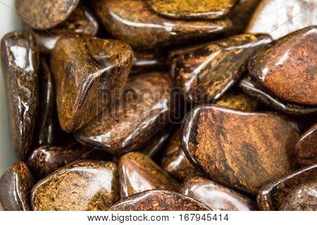 Natural processed ampulirovannye brown stone bronzite .