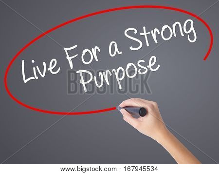 Woman Hand Writing Live For A Strong Purpose With Black Marker On Visual Screen