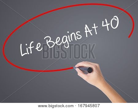 Woman Hand Writing Life Begins At 40  With Black Marker On Visual Screen