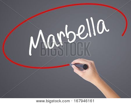 Woman Hand Writing Marbella With Black Marker On Visual Screen