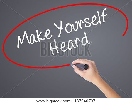 Woman Hand Writing Make Yourself Heard With Black Marker On Visual Screen
