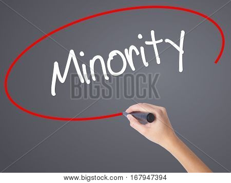 Woman Hand Writing Minority With Black Marker On Visual Screen
