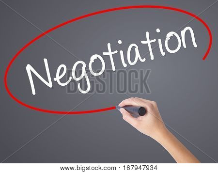 Woman Hand Writing Negotiation  With Black Marker On Visual Screen.