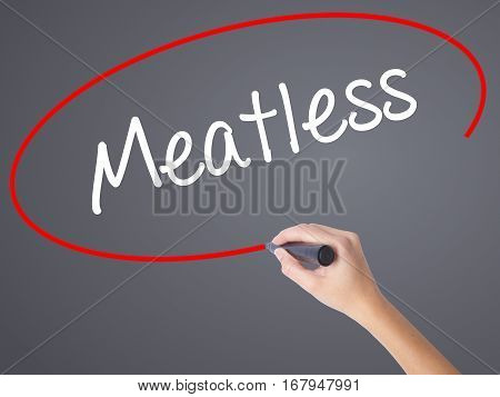 Woman Hand Writing Meatless  With Black Marker On Visual Screen