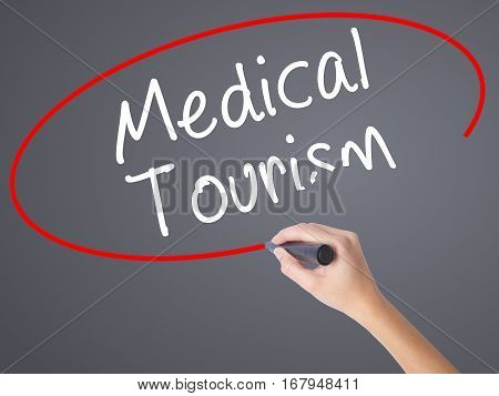 Woman Hand Writing Medical Tourism With Black Marker On Visual Screen