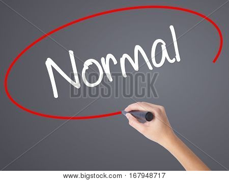 Woman Hand Writing Normal With Black Marker On Visual Screen
